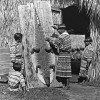 1930 A Seminole attaches an alligator hide to boards for drying