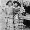 Jimmie Osceola(SHO-KEE,Left) Lena Frank(HAL-WE-CHEE)holding her daughter, Ethel Frank