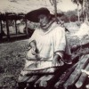 Mary Osceola Huff (Bird clan)sifting corn meal into a palmetto splint basket,Brighton Res1960