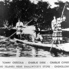 Seminole men in a dugout canoe - Chokoloskee, Florida