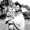 Seminole woman Leona Smith holding a child