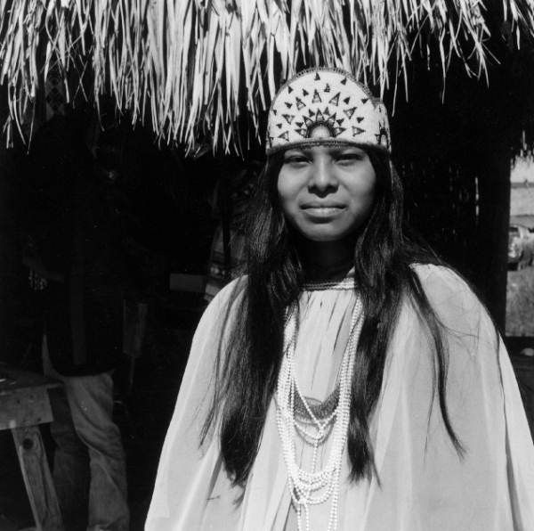 Young Seminole woman wearing a decorated headdress - Hollywood, Fl 1973